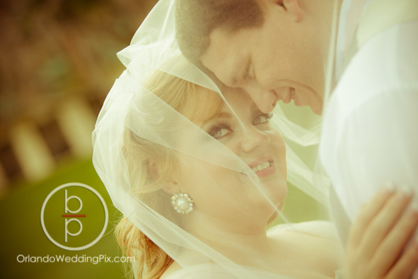 Disney-Fairytale-wedding-Shades-of-Green-Resort-At-Last-Wedding-and-Event-Design-Orlando-Wedding-Pix-A-Chair-Affair-Event-Rentals-Orlando-Bride-Groom-Under-Veil