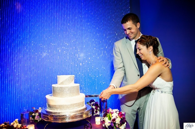 Purple wedding, Orange County Regional History Center, The Chapel at the Towers, Jennifer Werneth Photography, A Chair Affair Event Rentals, couple cutting cake