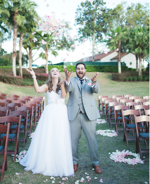 Emory and Jon with rose petals, Winter Park Racquet Club, Emory and Jon wedding, A Chair Affair Event Rentals