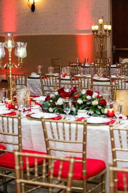 Lake-Mary-Events-Center-Nancy-Faircloth-Photography-Filigree-Chargers-Gold-Flatware-Gold-Rim-Stemware-A-Chair-Affair-Event