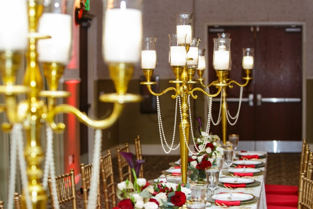 Lake-Mary-Events-Center-Nancy-Faircloth-Photography-Gold-Chiavari-Chairs-Red-Chair-Pads-Gold-Candelabras-A-Chair-Affair-Event