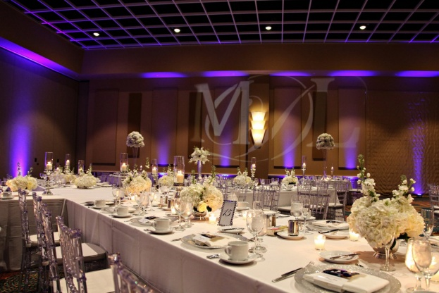 Rosen-Centre-Bride-Tab-McCausland-Photography-Guest-Table-Numbers-Clear-Chiavari-Chairs-Silver-Glitter-Glass-Chargers-Lee-Forrest-Design-A-Chair-Affair-Event