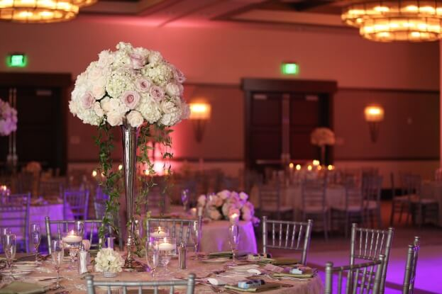 The-Alfond-Inn-Live-Happy-Studio-Silver-Chiavari-Chairs-White-Chair-Pads-Over-the-Top-Raining-Roses-White-Wedding-Ideas-A-Chair-Affair-Event