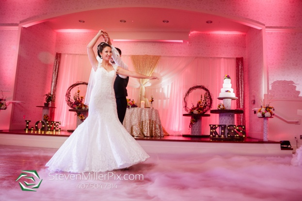 pink uplighting rustic wedding reception