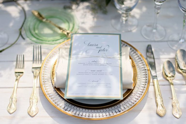 elegant seaside inspired shoot gold charger and gold flatware