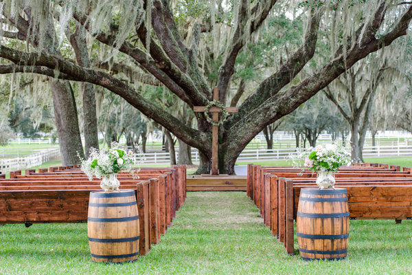 lange farm wedding church pews, whiskey barrels
