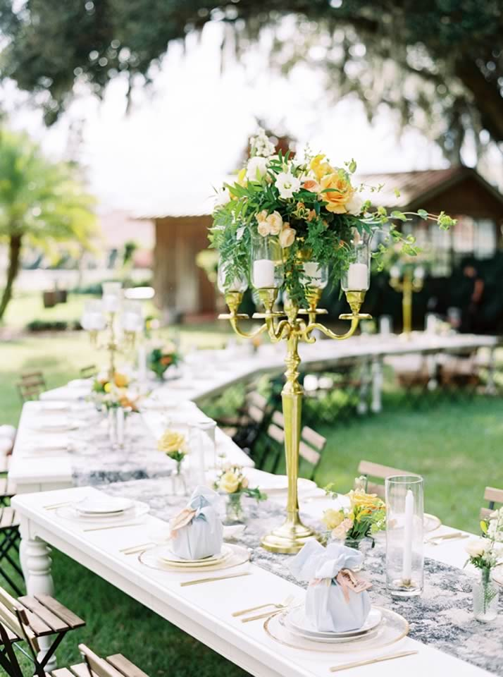 sophisticated yellow pale blue wedding inspiration gold candelabra