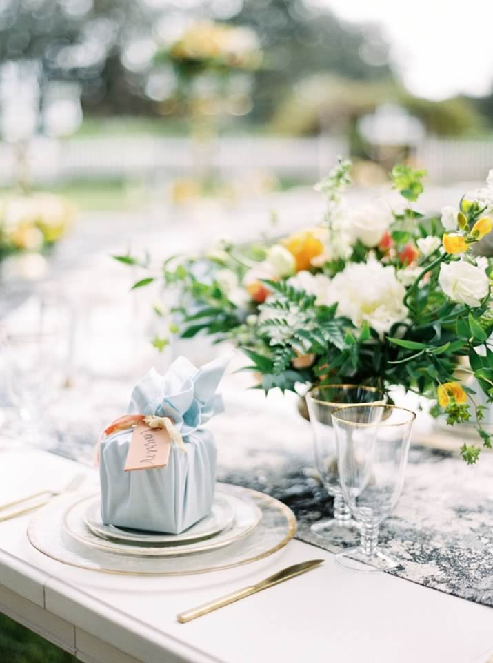 sophisticated yellow pale blue wedding inspiration gold rimmed charger and stemware