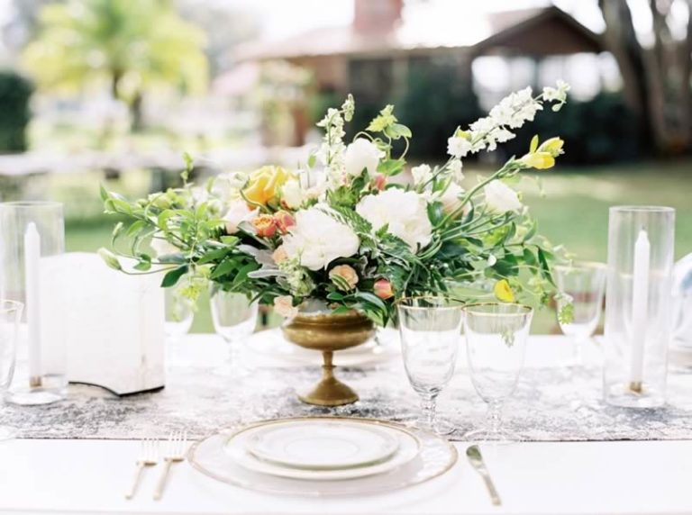 sophisticated yellow pale blue wedding inspiration gold rimmed charger, flatware and stemware