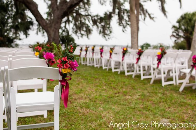 vibrant spring wedding white folding chairs