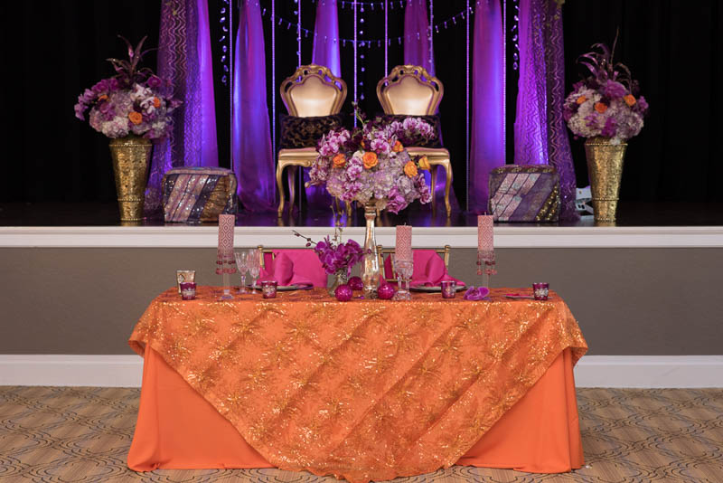 purple and gold indian themed styled shoot gold specialty chairs reception decor, specialty seating