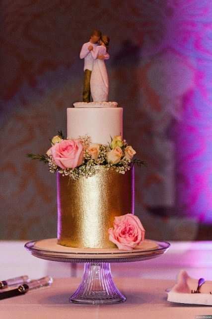 rich cream and shimmering gold wedding cake