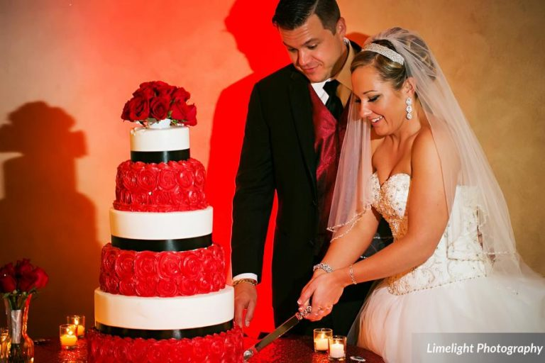 vivacious red and black mordern wedding cake cutting