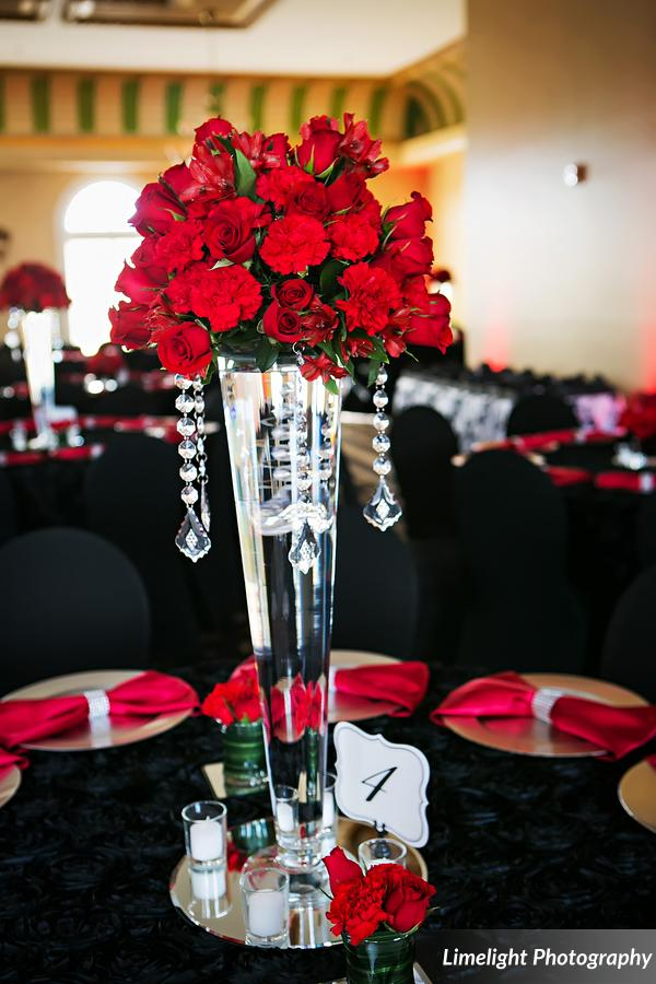 vivacious red and black mordern wedding centerpiece