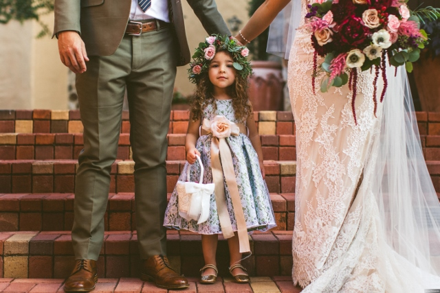 bella collina breathtaking ox blood gold wedding, flower girl with bride and groom
