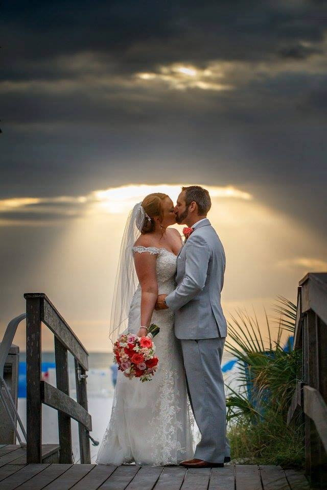colorful wedding on the beach, sunset