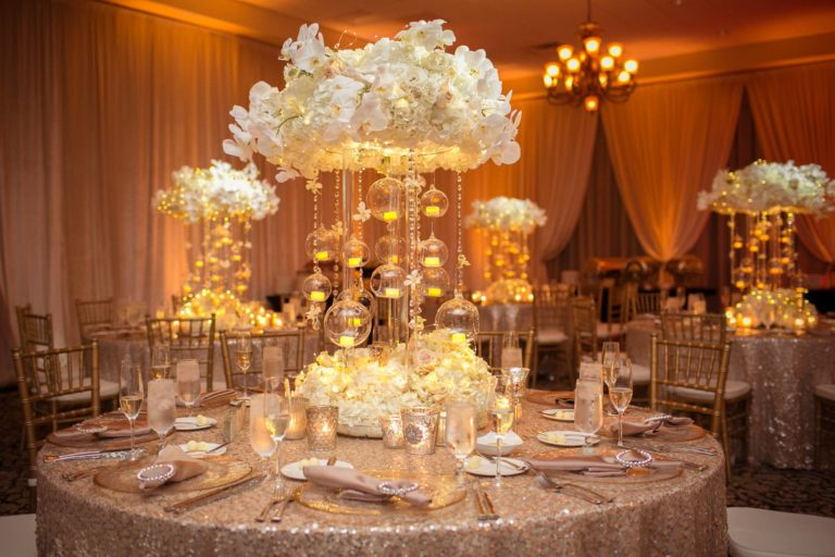 ivory and gold bella collina wedding, centerpieces