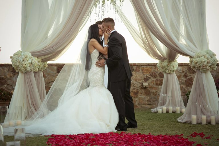 ivory and gold bella collina wedding, first kiss