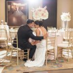 Gold Grand Bohemian Wedding reception couple