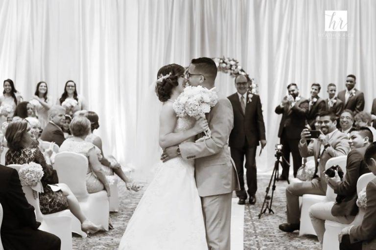 MIssion Inn Resort Wedding ceremony kiss