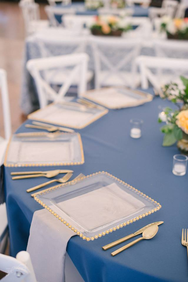 Bartow Tent Wedding A Chair Affair flatware gold belmont charger