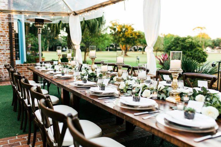 Casa Feliz Wedding A Chair Affair gold rim chargers mahogany tables