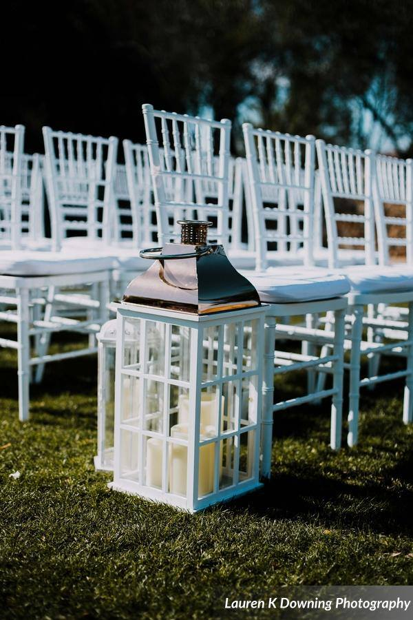 Bella Collina Wedding A Chair Affair white folding chairs 1