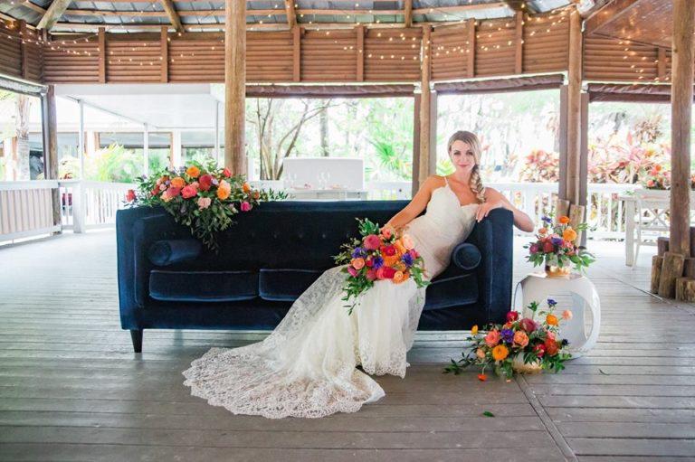 Paradise Cove wedding A Chair Affair blue brighton sofa rio end table