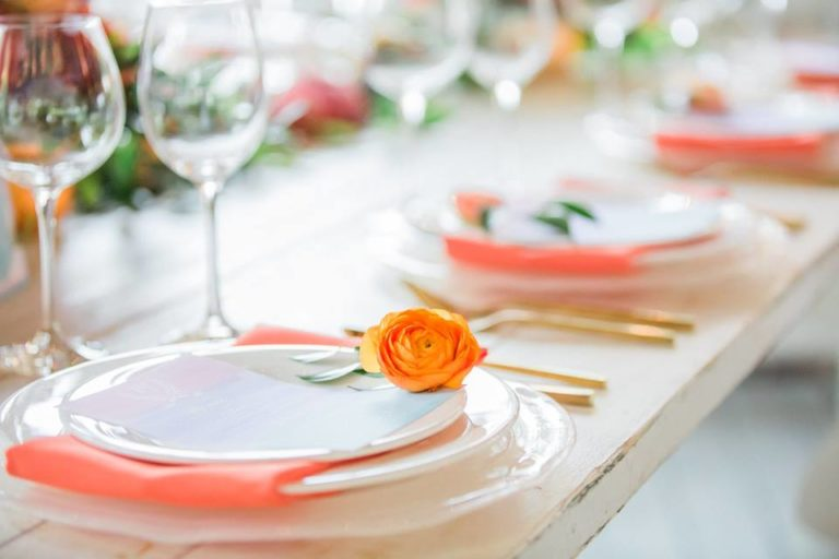 Paradise Cove wedding A Chair Affair farm table swirl charger coral napkin gold brushed flatware