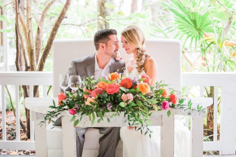 Paradise Cove wedding A Chair Affair mod furniture half moon table 2