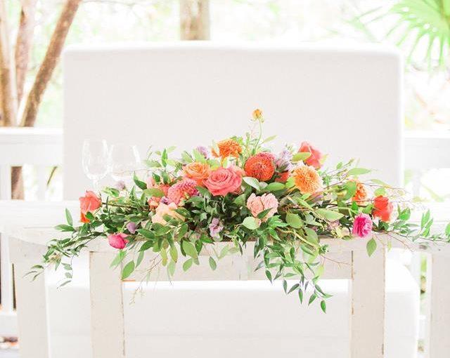 Paradise Cove wedding A Chair Affair mod furniture half moon table