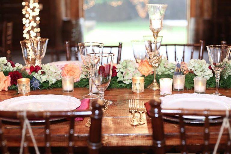 Enchanting Barn Wedding Inspiration A Chair Affair chiavari chair farm table gold stemware gold flatware
