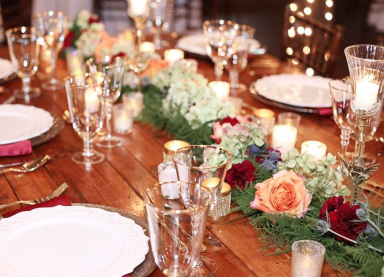 Enchanting Barn Wedding Inspiration A Chair Affair gold flateware gold stemware champagne charger 1