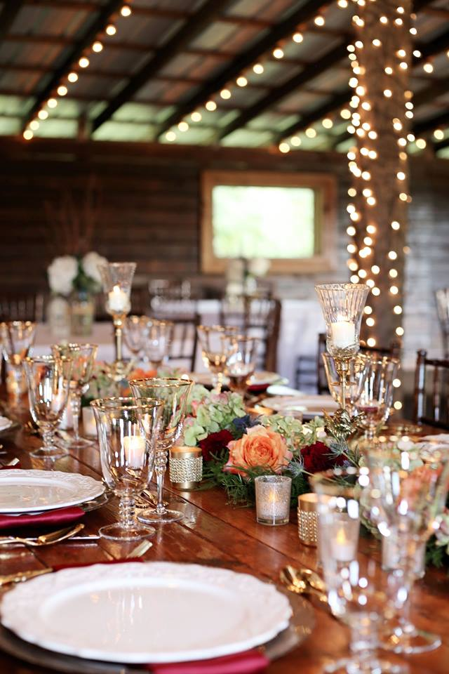Enchanting Barn Wedding Inspiration A Chair Affair gold flateware gold stemware champagne charger 3