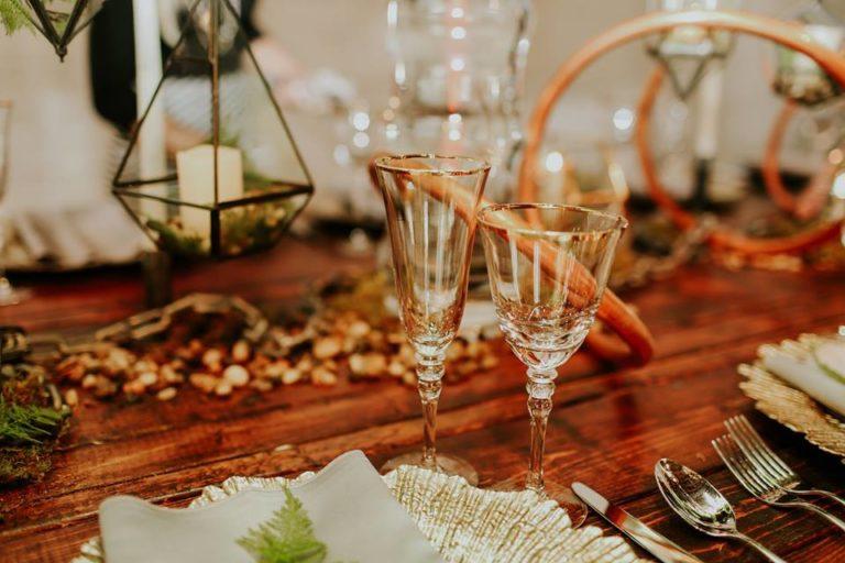 industrial wedding inspiration a chair affair farm table gold stemware