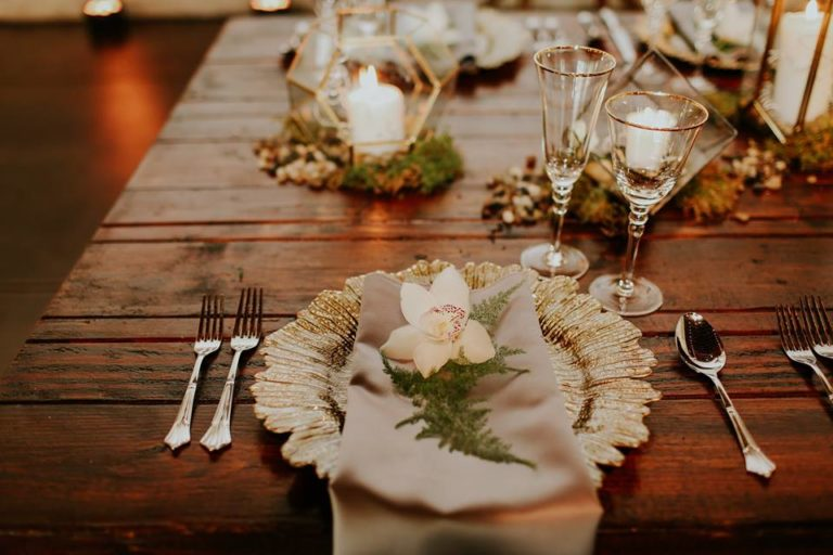 industrial wedding inspiration a chair affair farm table gold stemware gold seaburst charger 3