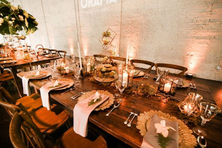 industrial wedding inspiration a chair affair farm table gold stemware gold seaburst charger 4