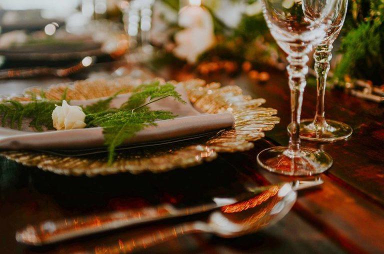 industrial wedding inspiration a chair affair gold seaburst charger gold stemware farm table 1