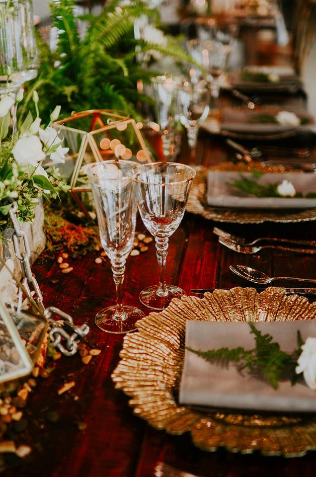 industrial wedding inspiration a chair affair gold seaburst charger gold stemware farm table 2