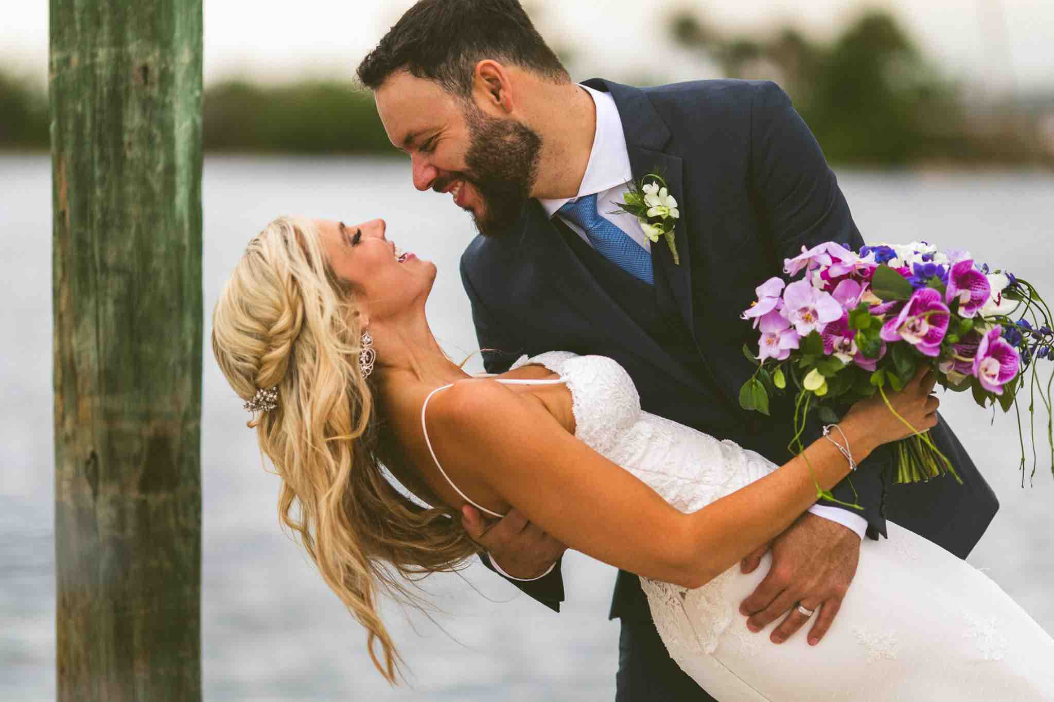 Waterfront Wedding at Eau Gallie Yacht Club A Chair Affair Newlyweds