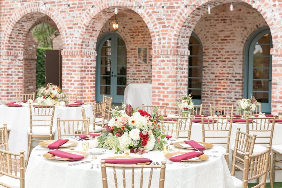 Casa Feliz Wedding A Chair Affair gold chiavari chairs gold chargers