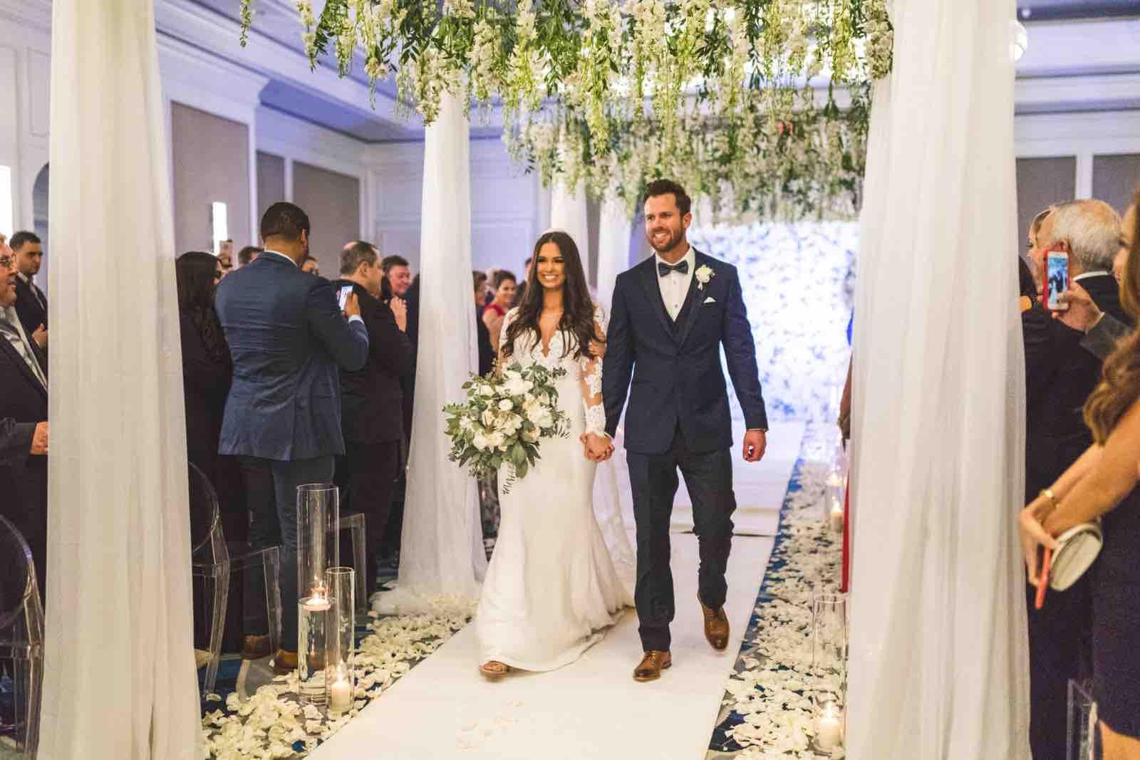 Ivory and Gold Wedding at the Ritz Carlton Sarasota wedding a chair affair Aisle