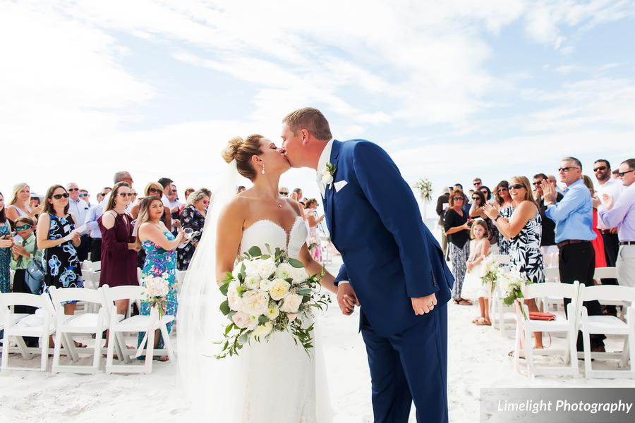 Hilton Clearwater Beach Wedding A Chair Affair Couple with White Folding Chairs