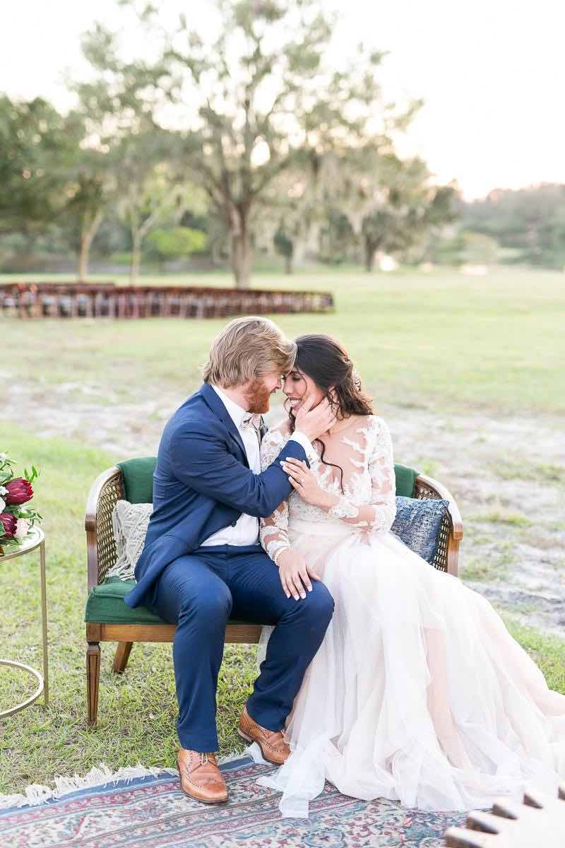 vintage-inspired farm wedding A Chair Affair newlywed couple