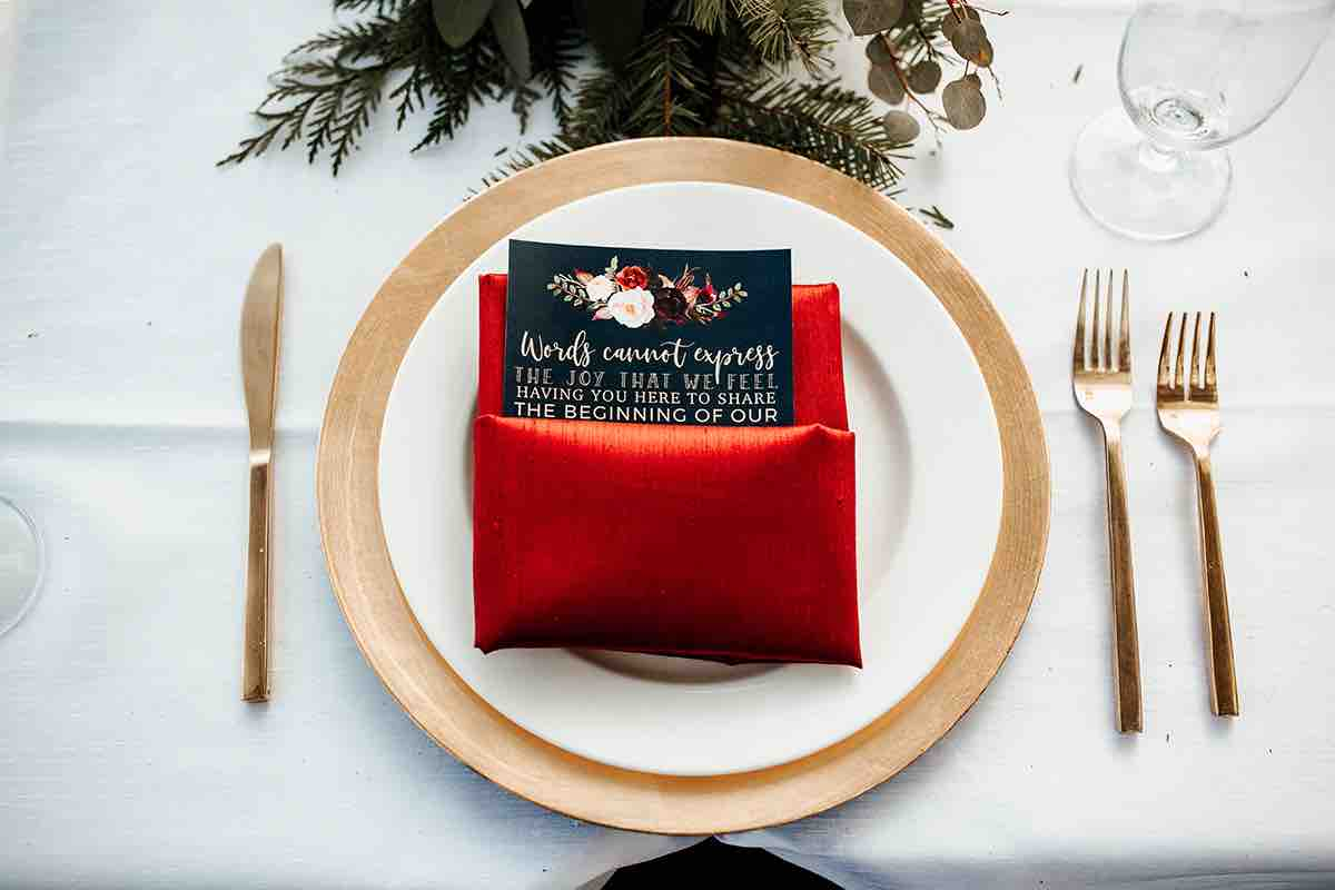 Christmas Wedding A Chair Affair Reception Gold Glass Charger and Brushed Gold Flatware