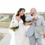 Ivory and gold Bella Collina wedding A Chair Affair Christian and Jackie smiling