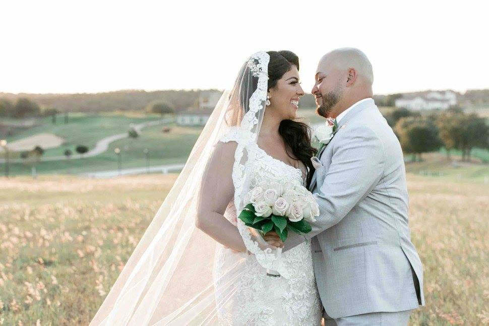 Ivory and gold Bella Collina wedding A Chair Affair newlyweds