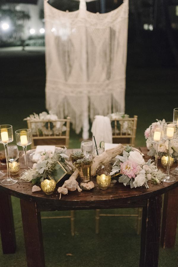 boho chic beach wedding A Chair Affair gold chiavari chairs and sweetheart table