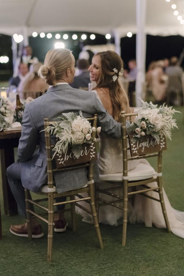 8bf12d1fed boho chic beach wedding couple at sweetheart table with gold chiavari chairs