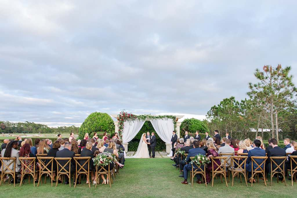 navy and burgundy wedding A Chair Affair French country chairs during ceremony